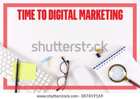 High angle view of various office supplies on desk with a word TIME TO DIGITAL MARKETING - stock photo
