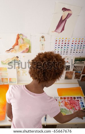 High angle view of woman painting in art studio - stock photo