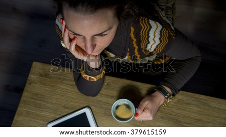 high angle view of woman with coffee and tablet