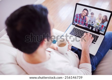 High angle view of young man using his laptop against handsome designer sit in his office - stock photo