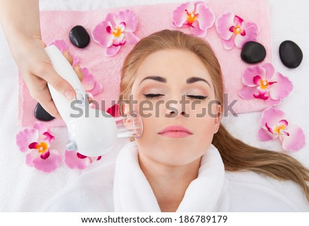 High Angle View Of Young Woman Getting Laser Therapy In Spa - stock photo