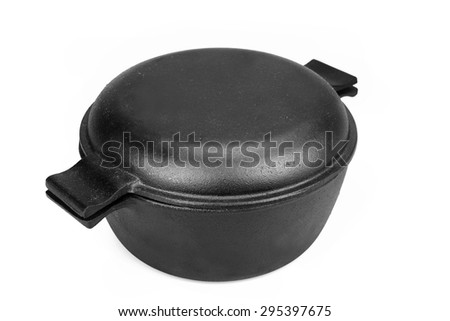 High Angle View On The Closed Clean Empty Cast Iron Pan Isolated On White Background Close-up - stock photo