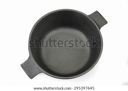 High Angle View On The Opened Clean Empty Cast Iron Pan Isolated On White Background Close-up - stock photo