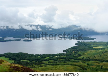 high angle view showing a cloudy scenery in Scotland around Loch Lomond - stock photo