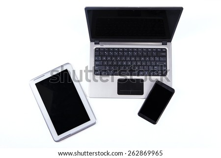 High angle view table of digital tablet with laptop computer and smartphone - stock photo
