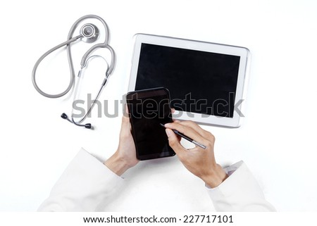 High angle view table of doctor hands working with smartphone and digital tablet