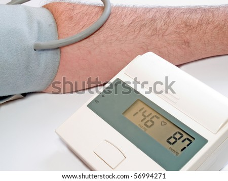 high blood pressure measuring with automatic tonometer - stock photo