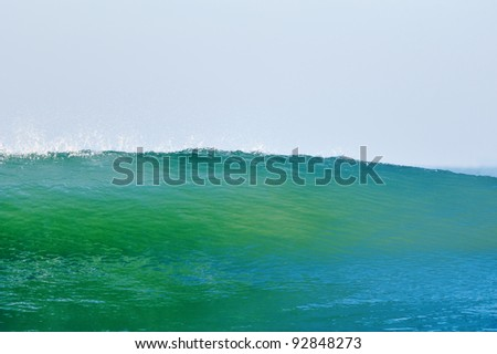 High blue-green sea wave on the background sky - stock photo