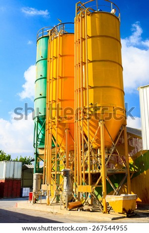 High bright round metal towers on chemical plant - stock photo