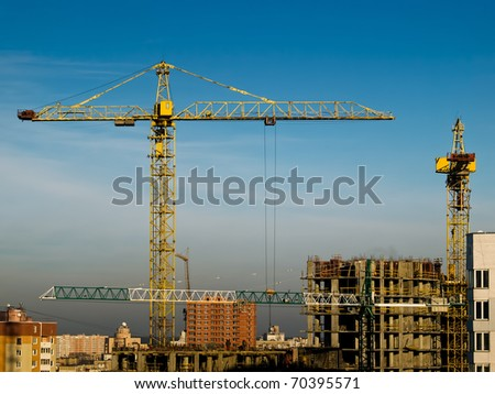 high building crane on the construction - stock photo
