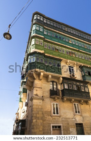 High building in Valletta Malta. Anglo saxon style with different green levels - stock photo