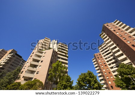 High Buildings on Blue Sky / Three tall buildings with trees and blue sky  - stock photo
