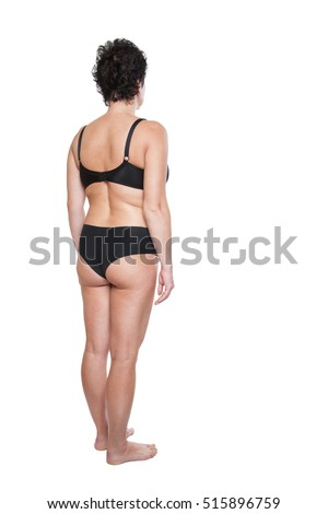 High-calorie meal, a man isolated on white background. foot. big woman on a white background. How to lose weight. Fat woman with measuring tape around her belly, a concept to start diet. Fat woman