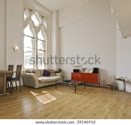 high ceiling apartment with large gothic windows - stock photo