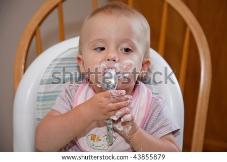 High chair is a piece of furniture used for feeding older babies and younger toddlers. - stock photo