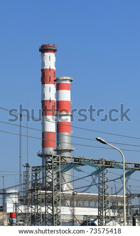 High chimneys of an industrial facility - stock photo