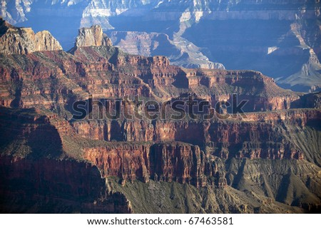 High cliffs above Bright Angel canyon, major tributary of the Grand Canyon, Arizona, USA.  View from the north rim. - stock photo