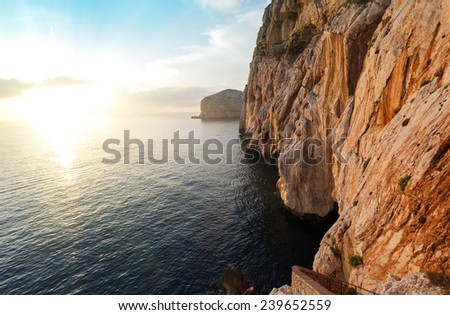 high cliffs and sea, Neptune Grotto in Sardinia, Italy - stock photo