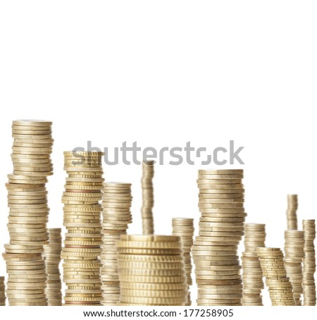 high coin towers representing the richness isolated - stock photo