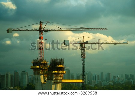 High construction against the distant landscape of Sao Paulo in Brazil - stock photo