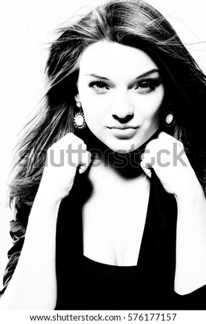 High contrast black and white portrait of beautiful girl with fluttering hair