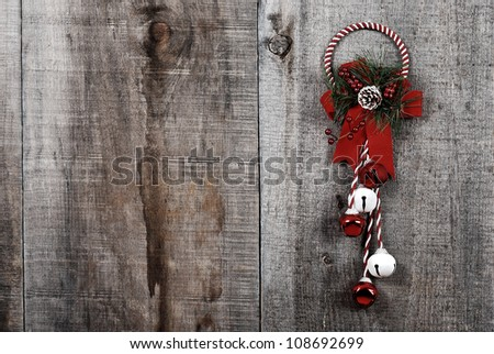 High contrast grunge Christmas decoration hanging on wood - stock photo