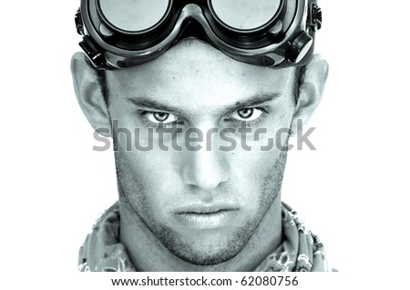 High contrast image of a construction worker with goggles isolated in white