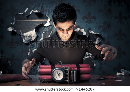 high contrast image of a terrorist making a time bomb - stock photo
