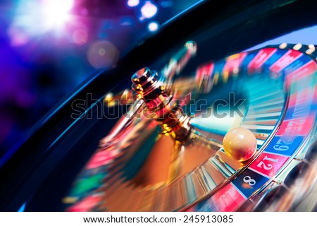 high contrast image of casino roulette in motion - stock photo