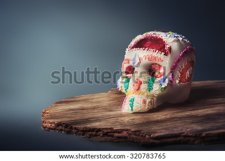 "High contrast image of sugar skull used for ""dia de los muertos"" / day of the dead celebration in a grey background - stock photo"