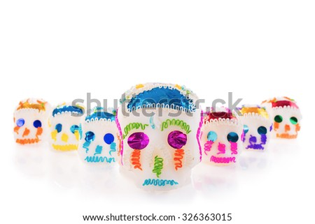 "High contrast image of sugar skulls used for ""dia de los muertos"" celebration isolated on white - stock photo"