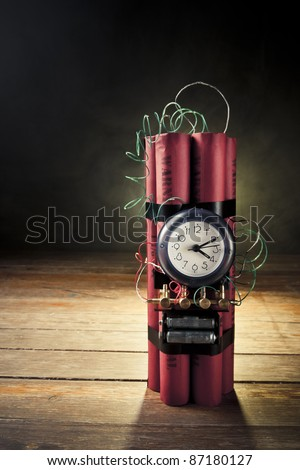 high contrast image of timebomb with smoke - stock photo