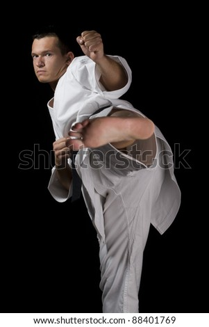 High Contrast karate young fighter - stock photo