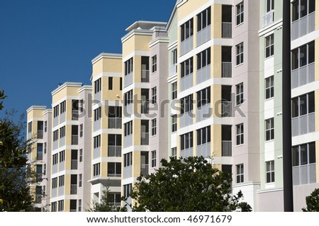 High contrast multi colored high rise condominiums with individual balcony's - stock photo
