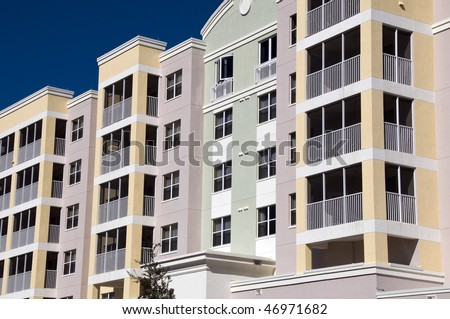 High contrast multi colored high rise condominiums with individual balconys - stock photo