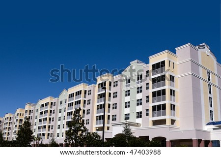 High contrast multi colored high rise condominiums with individual balconys and large area for text - stock photo