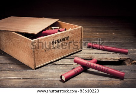 high contrast photo of dynamite sticks on a box - stock photo