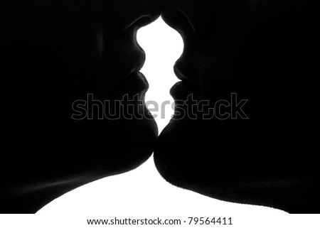 high-contrast twin portrait in backlight - stock photo