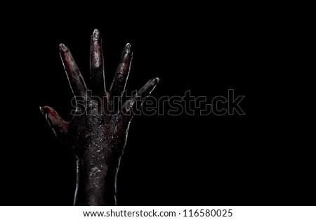 High contrast zombie hand on dark background. - stock photo