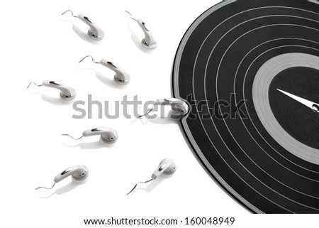 High contrasted abstraction made of gramophone record and earphones in situation of conception. - stock photo