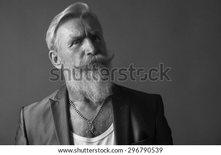High defenition portrait of a cool senior man with a white beard.Picture is black and white. - stock photo