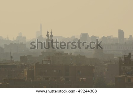 High density living in the smog and setting sun old Islamic Cairo quarter Egypt - stock photo