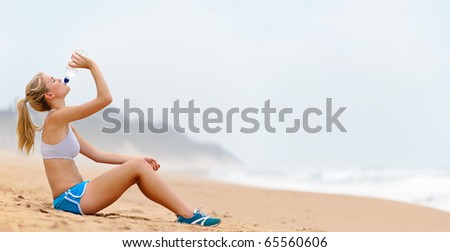 High detail panoramic image of sexy fitness girl drinking water - XXL image - stock photo