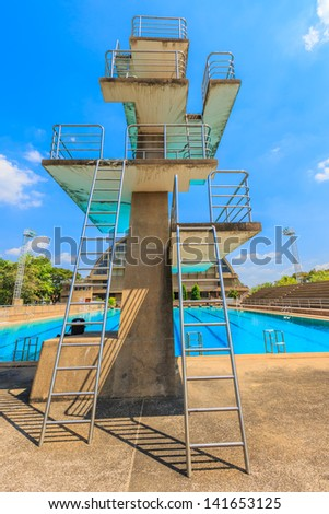 High diving board at a public swimming pool. - stock photo