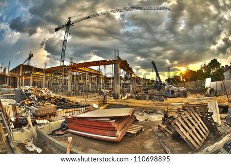 High dynamic range construction site with cranes - stock photo