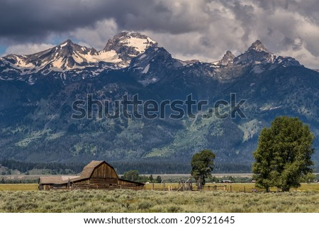 High Dynamic Range (HDR) Image of the Historic John Moulton barn and corral on Mormon Row in the Antelope Flats area of Grand Teton National Park, Wyoming - stock photo