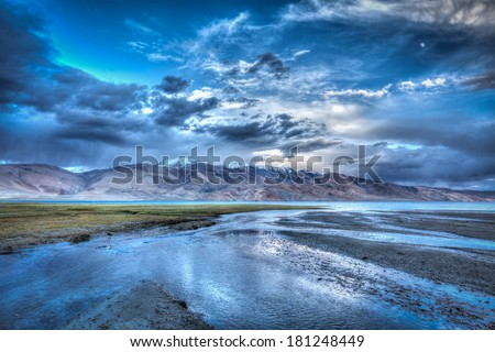 High dynamic range image (HDR) of Himalayan mountain lake in Himalayas Tso Moriri, Korzok,  Changthang area, Ladakh, Jammu and Kashmir, India - stock photo