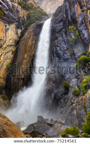 High dynamic range image of lower Yosemite falls with a powerful spring water flow - stock photo