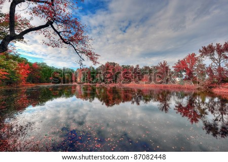 High Dynamic Range Landscape of a Maryland pond in Autumn near the Chesapeake Bay reflecting fall colors - stock photo