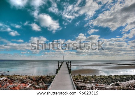 High Dynamic Range Landscape of a pier on the Chesapeake Bay in Maryland - stock photo